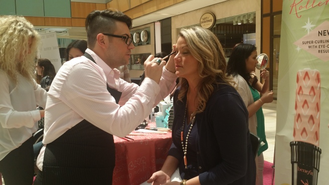 Benefit's Brandon Barnhard performs brow magic while I look on in envy (I was next). (All photos: JOY TIPPING, except as noted otherwise).
