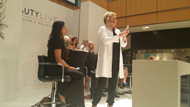"Clinique's regional education executive Lisa Boness does a makeover on a willing ""victim"" at the Belk panel."